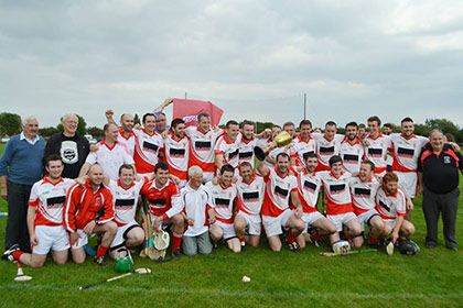 Cú Chulainns celebrate with the London Intermediate Hurling Championship Cup.