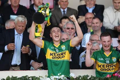 Kerry captain Liam Kearney lifts the Munster MFC trophy.<br />&#169;INPHO/James Crombie.