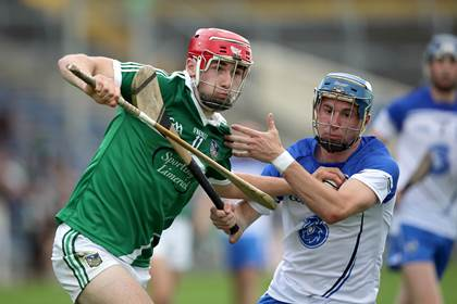 Limerick&#39;s Barry Nash with Conor Gleeson of Waterford.<br />&#169;INPHO/Morgan Treacy.