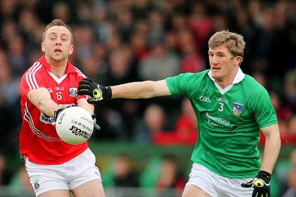 Limerick&#39;s Johnny McCarthy and Paul Kerrigan of Cork.<br />&#169;INPHO/Cathal Noonan.