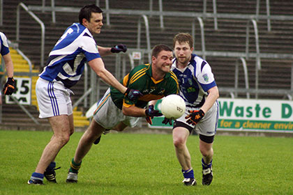 Ballymachugh's James Henry Fitzsimons is under pressure from Padraic O`Dwyer and Brian Cullen (Munterconnaught) during the Cavan IFC game at Breffni Park.