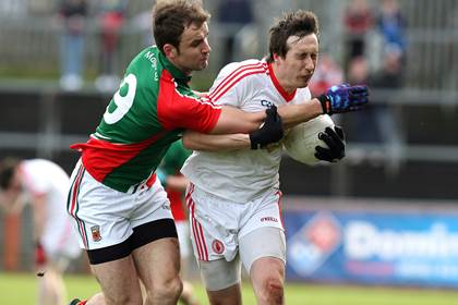 Tyrone&#39;s Colm Cavanagh and Jason Gibbons of Mayo.<br />&#169;INPHO/Presseye/Darren Kidd.