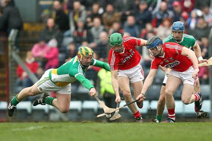 Offaly&#39;s Ger Healion with Seamus Harnedy and Conor Lehane of Cork.<br />&#169;INPHO/Donall Farmer.