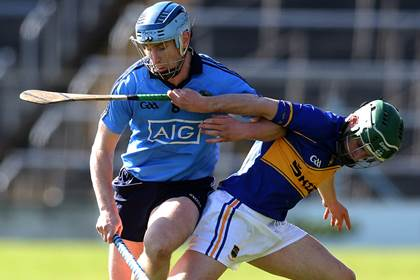 Dublin&#39;s Joey Boland with Cathal Barrett of Tipperary.<br />&#169;INPHO/Donall Farmer.