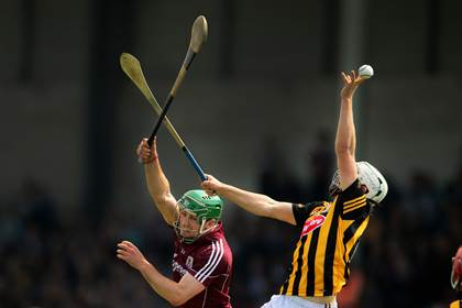Kilkenny&#39;s Padraig Walsh with David Burke of Galway.<br />&#169;INPHO/Cathal Noonan.