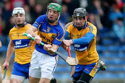 Tipperary&#39;s James Woodlock with Patrick Donnellan of Clare.<br />&#169;INPHO/Ryan Byrne.
