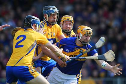 Tipperary&#39;s Seamus Callanan is tackled by David McInerney, Brendan Bugler and Cian Dillon of Clare.<br />&#169;INPHO/Cathal Noonan.