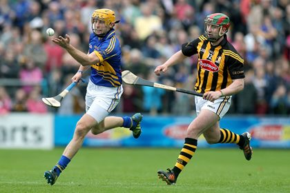 Shane McGrath of Tipperary with Kilkenny&#39;s Eoin Larkin.<br />&#169;INPHO/Ryan Byrne.