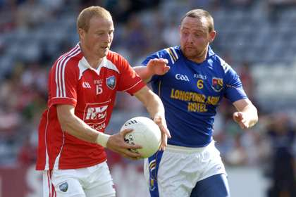 Louth's JP Rooney with Longford's Enda Williams