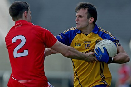 Cork&#39;s Jamie Davis with Donie Smith of Roscommon<br />&#169;INPHO