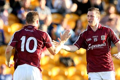 Galway&#39;s Danny Cummins and Michael Lundy celebrate another goal against Tipperary.<br />&#169;INPHO/James Crombie.