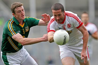 Tyrone&#39;s Stephen O&#39;Neill with Kevin Reilly of Meath.<br />&#169;INPHO/Ryan Byrne.