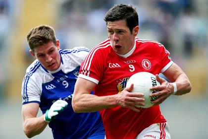 Monaghan&#39;s Darren Hughes and Sean Cavanagh of Tyrone.<br />&#169;INPHO/Ryan Byrne.