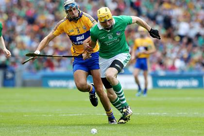 Limerick&#39;s David Breen and Brendan Bugler of Clare battle for possession.<br />&#169;INPHO/Lorraine O&#39;Sullivan.