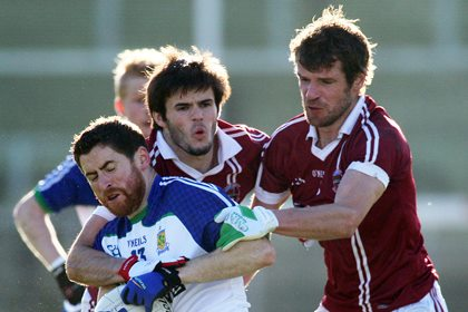 Ballinderry&#39;s Conleth Gilligan with Slaughtneil&#39;s Karl McKaigue and Francis McEldowney<br />&#169;INPHO