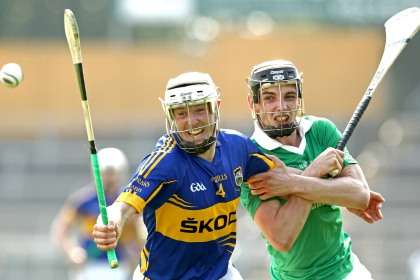Tipperary's Michael Cahill holds off Sean Tobin of Limerick during the Munster SHC game at Thurles ©INPHO/James Crombie
