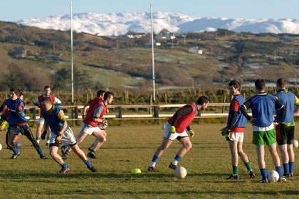 Naomh Conaill players training under snow capped mountains.