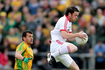 Donegal&#39;s Frank McGlynn and Martin Penrose of Tyrone.<br />&#169;INPHO/James Crombie.