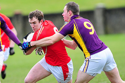 Bevan Duffy Louth gets the better of Wexford's Paddy Byrne in Div 3 league game in Drogheda