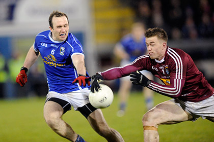 Cavan's Fergal Flanagan with Ger Egan Westmeath during the NFL Division 2 game at Breffni Park. Pic courtesy of Daniel Boyce Photography