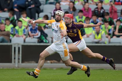 Antrim&#39;s Neil McManus with Lee Chin of Wexford <br />&#169;INPHO